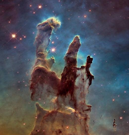 Noua imagine a Coloanelor Eagle Nebula ale Creației, surprinsă de Telescopul Hubble la începutul anului 2015. Sursă foto: Facebook Hubble Space Telescope
