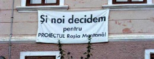 Banner pro Roșia Montană la o fereastră
