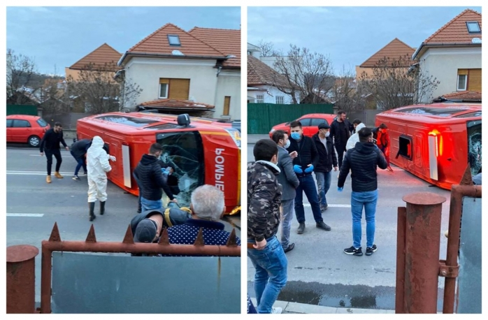Echipaj SMURD răsturnat pe strada G. Garibaldi. Transporta români proaspăt reveniți din Franța!, sursă foto: Info Trafic jud. Cluj
